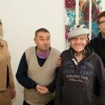 Sabine Funk mit Künstlern des Ateliers Querstrich